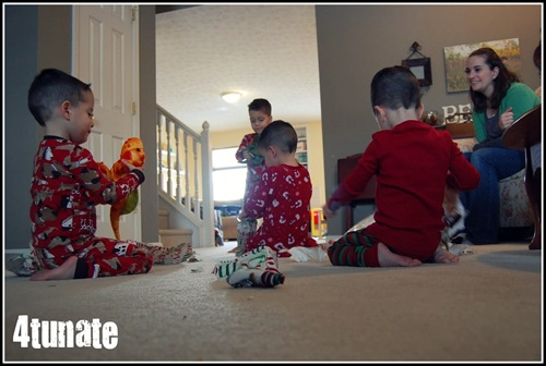boys opening presents christmas morning