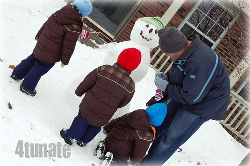 building a snowman with boys