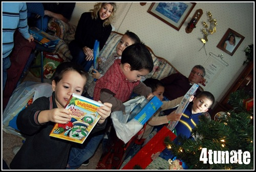 opening presents with lots of boys