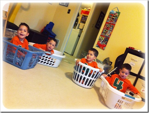 boys playing in laundry baskets