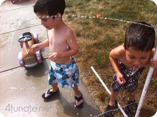 drinking water from sprinkler
