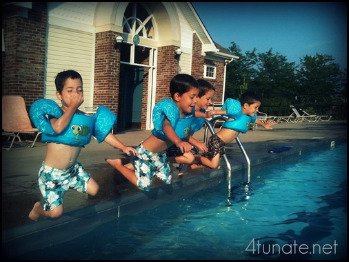 kids jumping in the pool