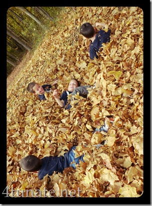kids playing in leaf piles fall fun