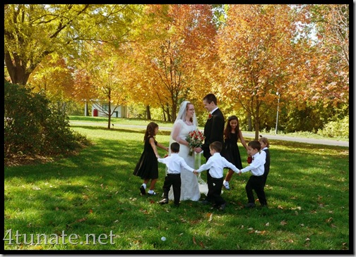 playing ring around the rosie for wedding pictures