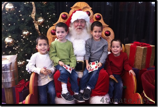 sitting on santa's lap at the christmas gift and hobby show