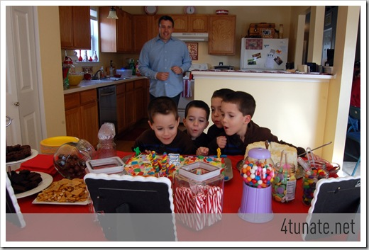 quadruplets birthday party blowing out candles