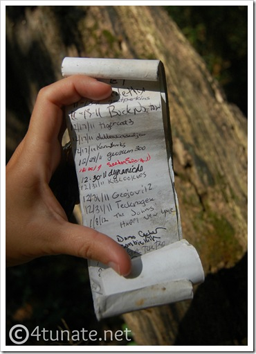 outdoor adventures for kids signing geocaching log